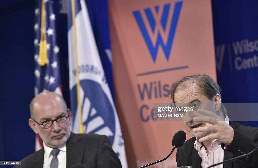 Mexico's Ambassador to Austria Luis Alfonso de Alba (L) watches as expert Carlos Martín Beristain (R) of Spain speaks on the report by the Interdisciplinary Group of Independent Experts on the disappearance of 43 students from the Rural Teachers College in Ayotzinapa, Mexico at the Wilson Center's Mexico Institute on May 25, 2016 in Washington, DC. / AFP / MANDEL