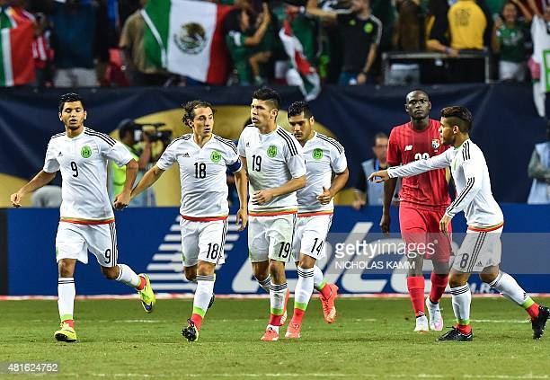 Mexico's Andres Guardado celebrates with Jesus Corona after scoring a penalty against Panama during a CONCACAF Gold Cup semifinal football match in...