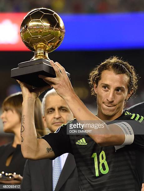 Mexico's Andres Guardado receives the golden ball award following the 2015 CONCACAF Gold Cup final against Jamaica on July 26 2015 in Philadelphia...