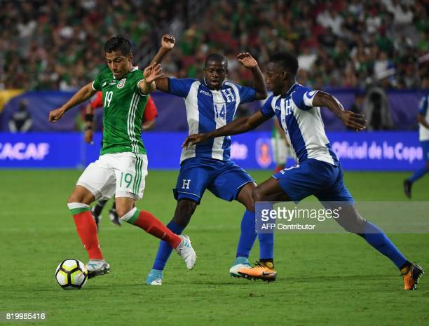 Mexico's Angel Sepulveda gets past Oscar Boniek Garcia of Honduras in their quarter final game during the 2017 CONCACAF Gold Cup at the University of...