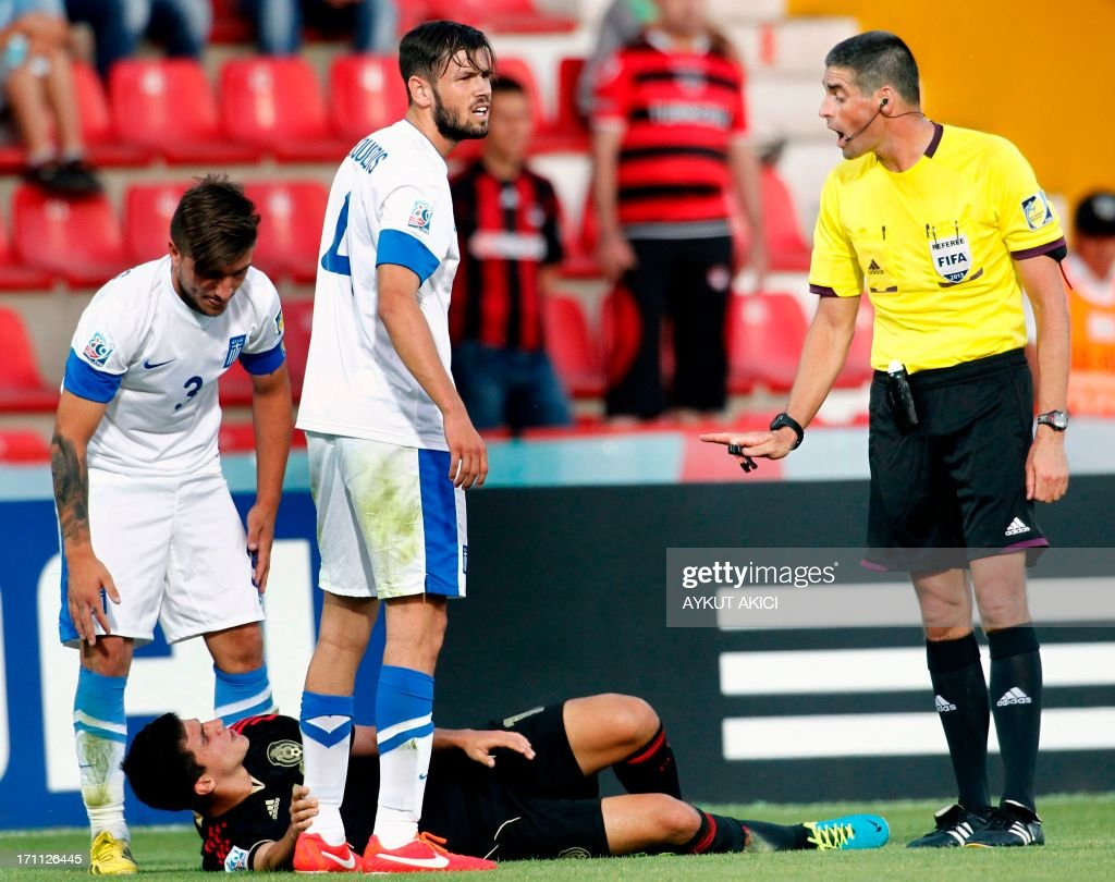 Mexico's Carlos Alberto Trevino (C) lays on the during during the group stage football match between Mexico and Greece at the FIFA Under 20 World Cup at the Kamil Ocak stadium in Gaziantep on June 22, 2013. AFP PHOTO/TURKPIX/Aykut AKICI=RESTRICTED TO EDITORIAL USE=