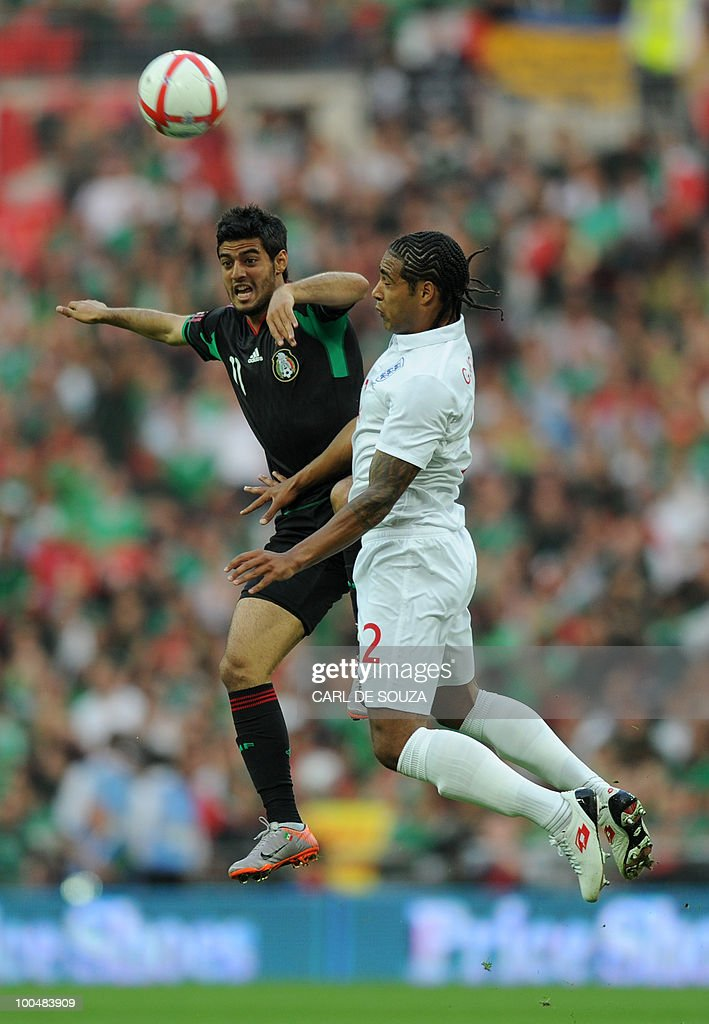 Mexico's Carlos Vela (L) challenges England's Glen Johnson during during their international friendly football match at Wembley Stadium in London on May 24, 2010 AFP PHOTO/Paul Ellis