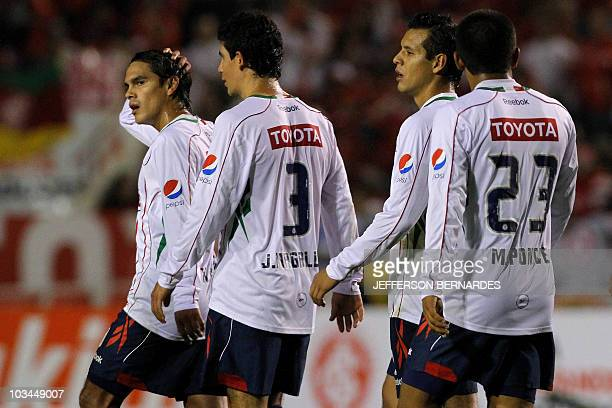 Mexico's Chivas players leave the field after their Libertadores final football match against Brazilian Internacional at Beira Rio stadium in Porto...