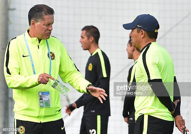 Mexico's Club America Chairman Ricardo Pelaez Linares talks with head coach Ignacio Ambriz during a morning football training session in Osaka on...
