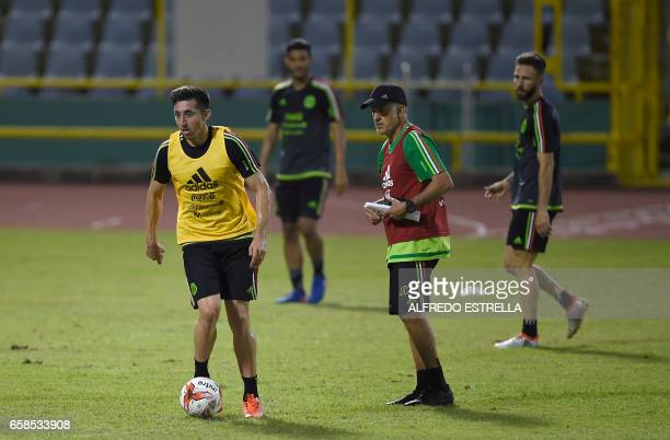 Mexico's coach Juan Carlos Osorio attends a training session at the Hasely Crawford Stadium in Port of Spain Trinidad and Tobago on March 27 2017 /...