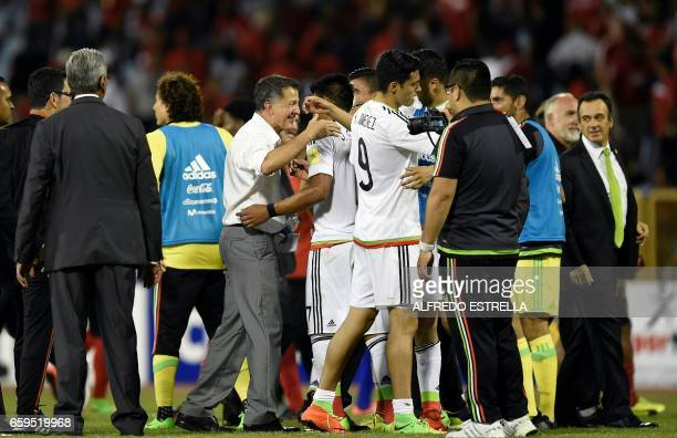 Mexico's coach Juan Carlos Osorio celebrates with members of his team after they defeat Trinidad Tobago during their 2018 FIFA World Cup qualifier...