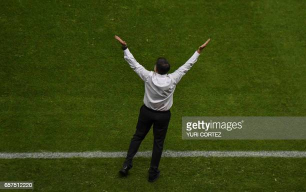 Mexico's coach Juan Carlos Osorio gestures during their 2018 FIFA World Cup qualifier football match against Costa Rica in Mexico City on March 24...