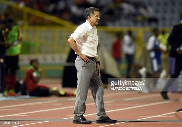 Mexico's coach Juan Carlos Osorio gestures during their 2018 FIFA World Cup qualifier football match against Trinidad Tobago in Port of Spain...