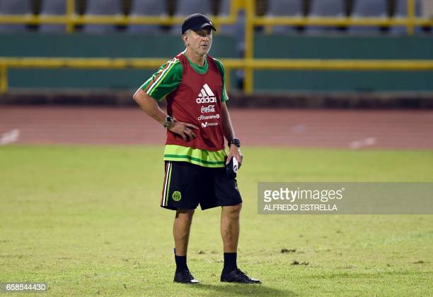Mexico's coach Juan Carlos Osorio takes part in a training session at the Hasely Crawford Stadium in Port of Spain Trinidad and Tobago on March 27...
