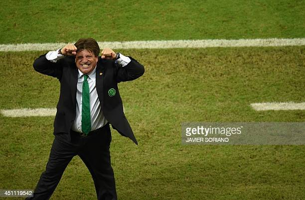 Mexico's coach Miguel Herrera celebrates after his team won a Group A football match between Croatia and Mexico at the Pernambuco Arena in Recife...