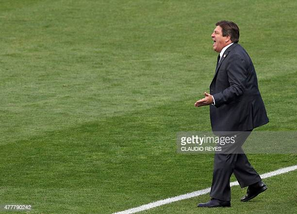 Mexico's coach Miguel Herrera gives instructions during the 2015 Copa America football championship match against Ecuador in Rancagua Chile on June...
