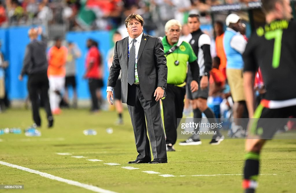 Mexico's coach <a gi-track='captionPersonalityLinkClicked' href=/galleries/search?phrase=Miguel+Herrera+-+Soccer+Coach&family=editorial&specificpeople=12319687 ng-click='$event.stopPropagation()'>Miguel Herrera</a> looks on during his team's CONCACAF Gold Cup Group C match against Trinidad and Tobago in Charlotte, North Carolina, on July 15, 2015. AFP PHOTO/NICHOLAS KAMM