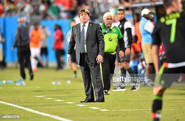 Mexico's coach Miguel Herrera looks on during his team's CONCACAF Gold Cup Group C match against Trinidad and Tobago in Charlotte North Carolina on...