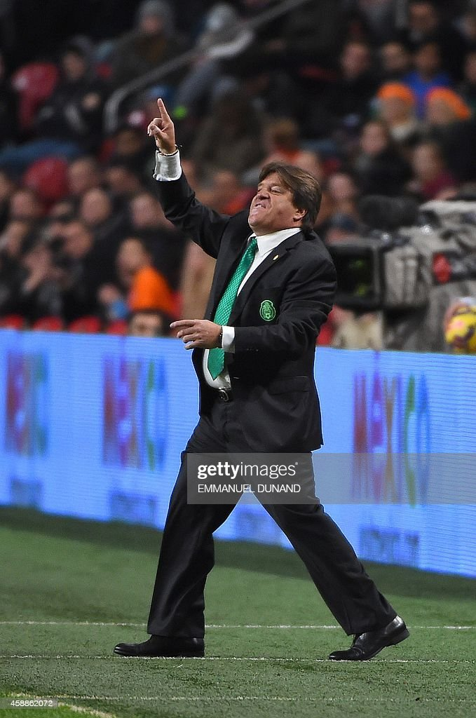 Mexico's coach <a gi-track='captionPersonalityLinkClicked' href=/galleries/search?phrase=Miguel+Herrera+-+Treinador+de+futebol&family=editorial&specificpeople=12319687 ng-click='$event.stopPropagation()'>Miguel Herrera</a> reacts during the friendly football match between the Netherlands and Mexico in Amsterdam, on November 12, 2014. Mexico won 3-2.