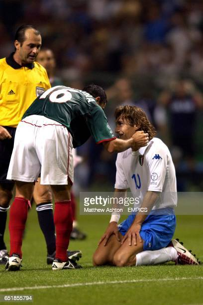 Mexico's Cuauhtemoc Blanco apologises for a late tackle on Italy's Francesco Totti
