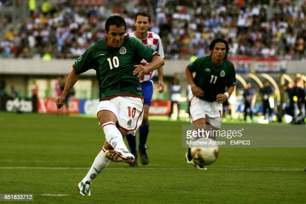 Mexico's Cuauthemoc Blanco scores the winning goal from the penalty spot