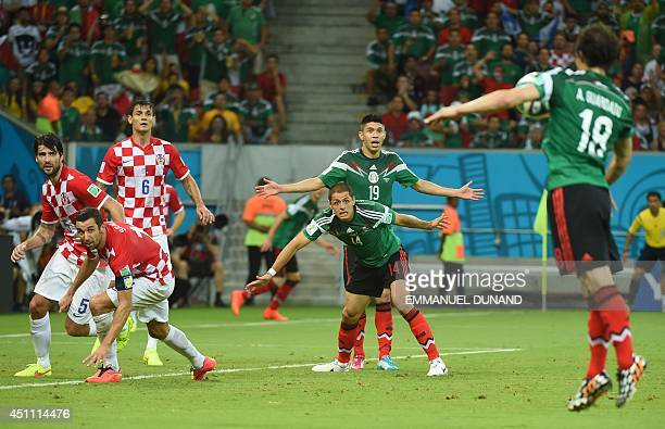 Mexico's defender Andres Guardado plays the ball as Croatia's defender Vedran Corluka Croatia's defender Darijo Srna and Croatia's defender Dejan...