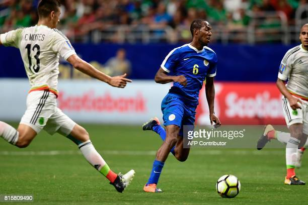 Mexico's defender Cesar Montes and Mexico's defender Jair Pereira defend as Curacao's forward Quenten Martinus drives up the field during the second...