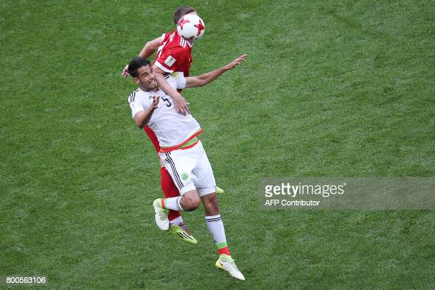 Mexico's defender Diego Reyes jumps for the ball during the 2017 Confederations Cup group A football match between Mexico and Russia at the Kazan...