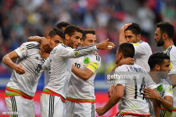 Mexico's defender Hector Moreno celebrates with team mates after scoring during the 2017 Confederations Cup group A football match between Portugal...