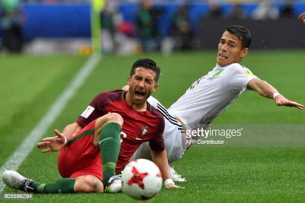 TOPSHOT Mexico's defender Hector Moreno challenges Portugal's midfielder Joao Moutinho during the 2017 FIFA Confederations Cup third place football...