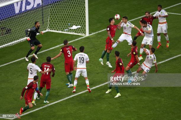 TOPSHOT Mexico's defender Hector Moreno heads the ball to score during the 2017 Confederations Cup group A football match between Portugal and Mexico...