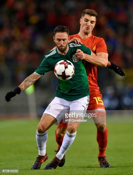 Mexico's defender Miguel Layun fights for the ball with Belgium's defender Thomas Meunier during the international friendly football match between...