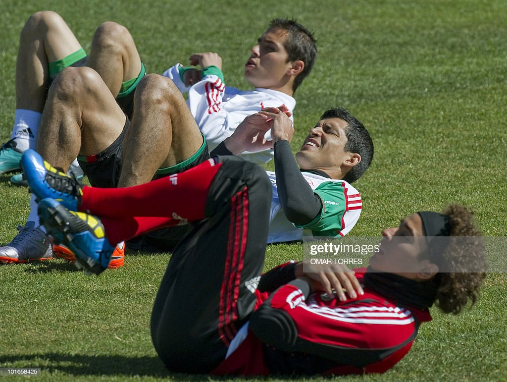 Mexico's defender Paul Aguilar, defender Francisco Rodriguez and goalkeeper Guillermo Ochoa make streching exercises during a training session of the Mexico national football team at the Waterstone College in Johannesburg on June 6, 2010. The 2010 World Cup will take place in South Africa from June 11 to July 11, the first time on African soil for the biggest and most prestigious competition in sport.
