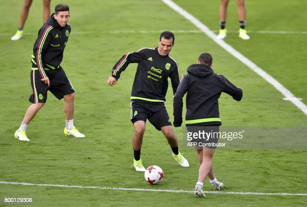 Mexico's defender Rafael Marquez forward Javier Hernandez and midfielder Hector Herrera attend to a training session at the Central stadium in Kazan...