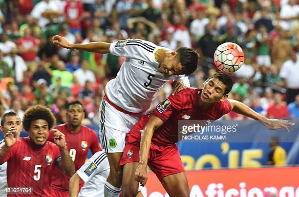 Mexico's Diego Reyes heads the ball over Panama's Valentin Pimentel during a CONCACAF Gold Cup semifinal football match in Atlanta on July 22 2015...