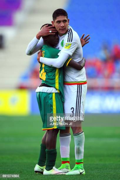 Mexico's Edson Alvarez hugs with Senegal's Ousseynou Niang after their U20 World Cup round of 16 football match between Mexico and Senegal in Incheon...