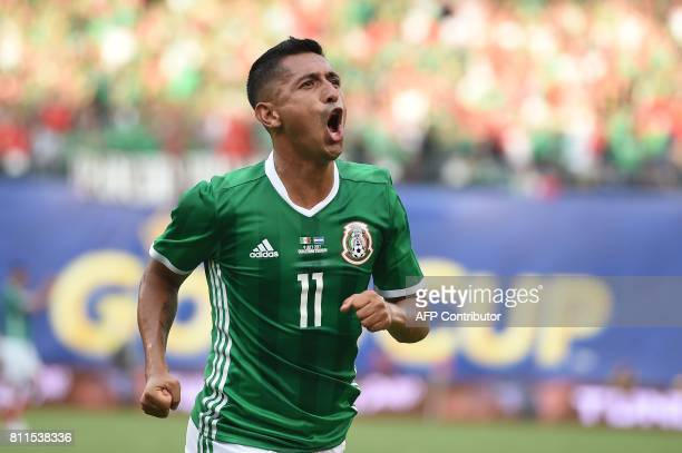 Mexico's Elias Hernandez celebrates his goal against El Salvador in Group C play in the 2017 CONCACAF Gold Cup July 9 2017 at Qualcomm Stadium in San...