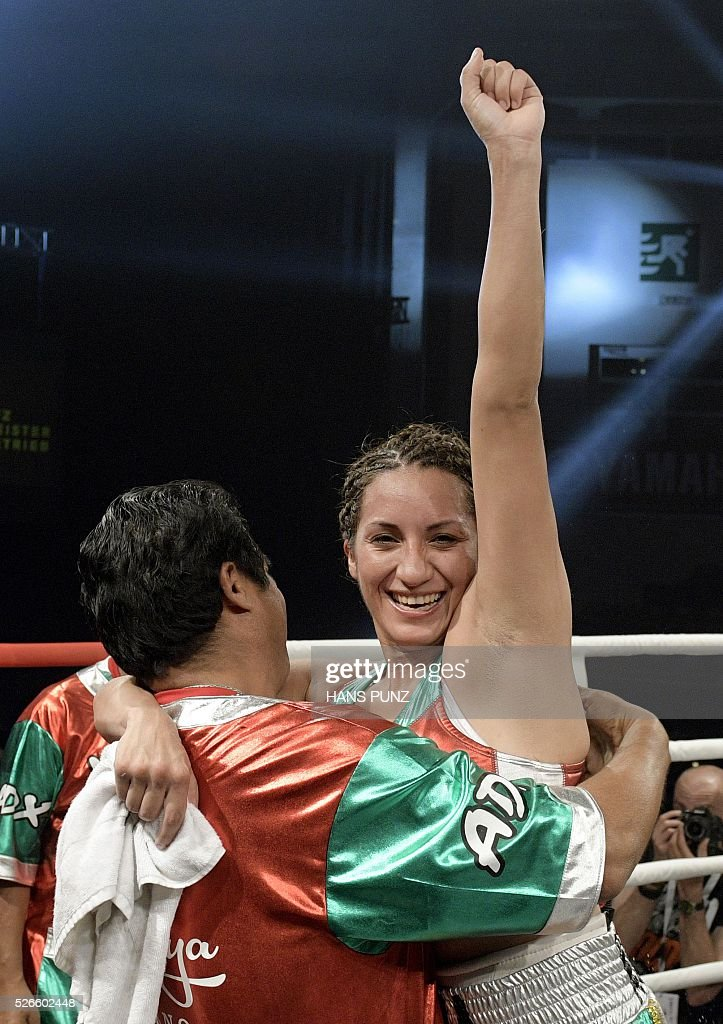 Mexico's Esmeralda Moreno celebrates after winning the WIBO Super Flyweight World Championship boxing fight in Vienna on April 30, 2016. / AFP / APA / HANS PUNZ / Austria OUT