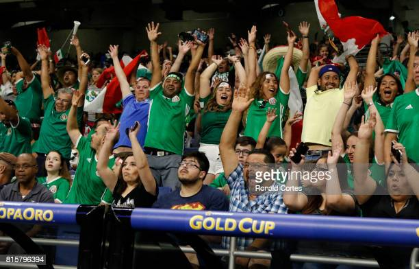 Mexico's fans cheer before the game against Curaco during the 2017 CONCACAF Gold Cup at Alamodome on July 16 2017 in San AntonioTexas