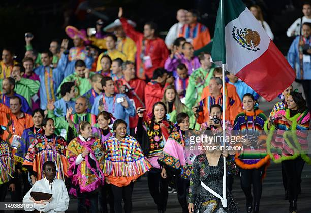 Mexico's flagbearer Maria del Rosario Espinoza leads her delegation as they parade during the opening ceremony of the London 2012 Olympic Games in...