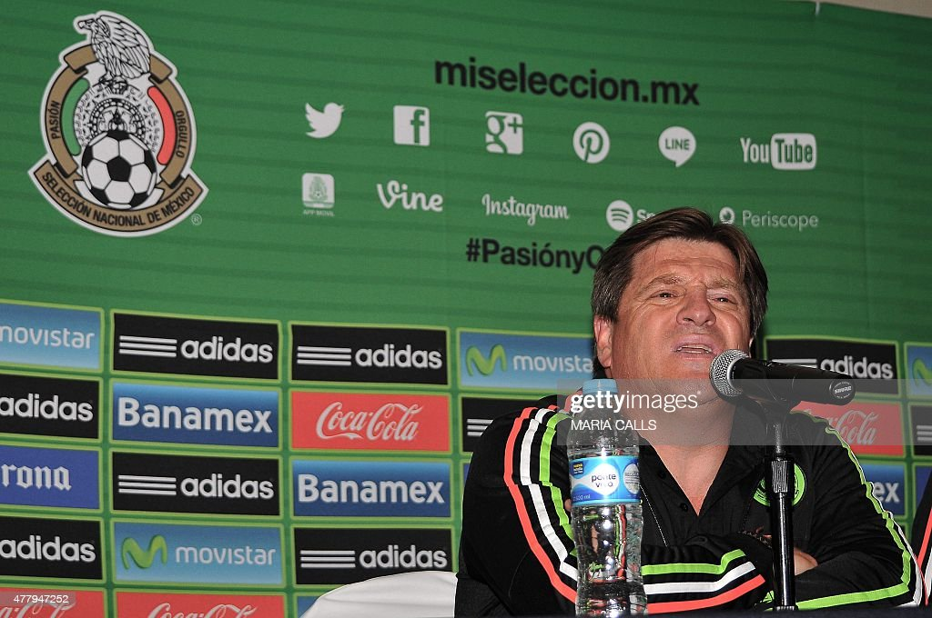 Mexico´s football national team coach <a gi-track='captionPersonalityLinkClicked' href=/galleries/search?phrase=Miguel+Herrera+-+Soccer+Coach&family=editorial&specificpeople=12319687 ng-click='$event.stopPropagation()'>Miguel Herrera</a> speaks during a press conference after his arrival in Mexico on June 20, 2015, in Mexico city. The Mexican team was out of the tournament after being defeated by Ecuador during the 2015 Copa America football championship. AFP PHOTO/MARIA CALLS