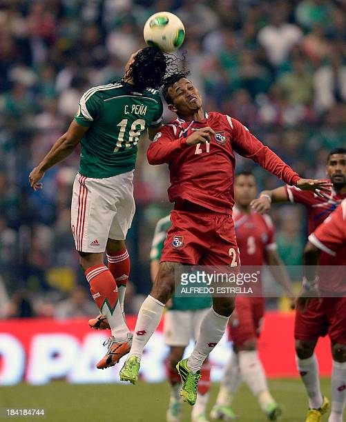 Mexico's footballer Carlos Pena and Panama's Amilcar Henriquez jump for the ball during their Brazil 2014 FIFA World Cup CONCACAF qualifier match at...