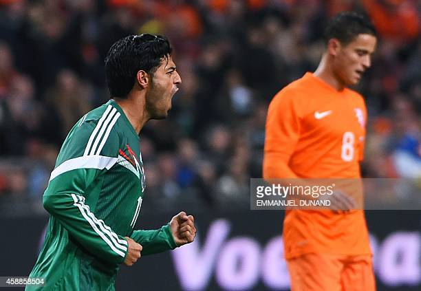 Mexico's forward Carlos Vela celebrates after scoring the first goal during the friendly football match betwenn the Netherlands and Mexico in...