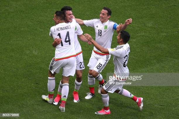 Mexico's forward Hirving Lozano celebrates a second goal during the 2017 Confederations Cup group A football match between Mexico and Russia at the...