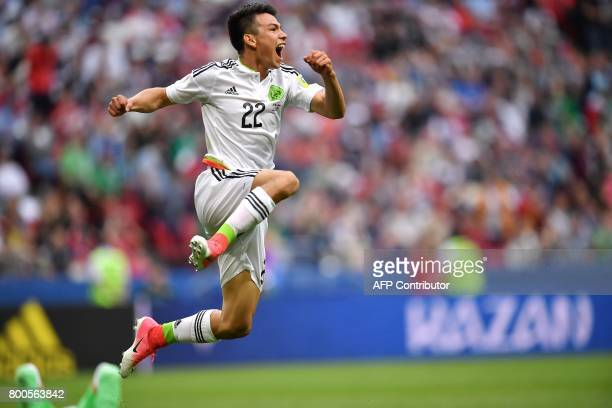 Mexico's forward Hirving Lozano celebrates after scoring the team's second goal during the 2017 Confederations Cup group A football match between...