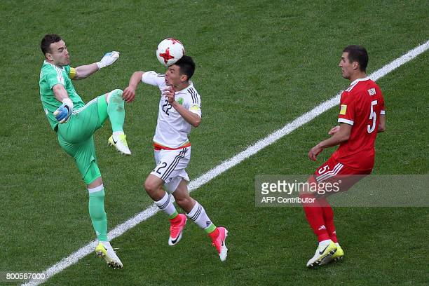 Mexico's forward Hirving Lozano shoots to score the team's second goal during the 2017 Confederations Cup group A football match between Mexico and...