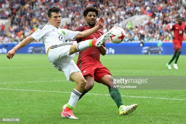 Mexico's forward Hirving Lozano vies with Portugal's defender Eliseu during the 2017 Confederations Cup third place football match between Portugal...