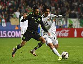 Mexico's forward Javier Aquino vies for the ball with Bolivia's defender Marvin Bejarano during their Copa America football match against Mexico in...