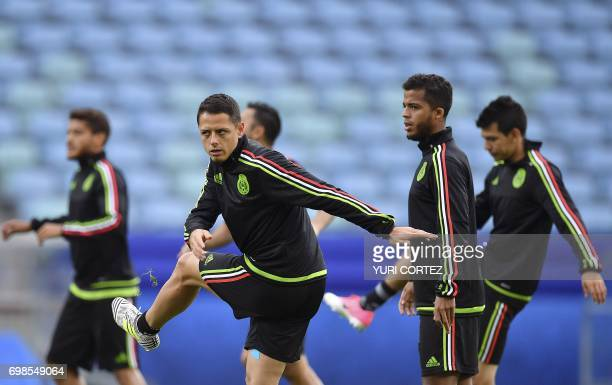 Mexico's forward Javier Hernandez and Mexico's midfielder Giovani Dos Santos take part in a training session with teammates at the Fisht stadium in...