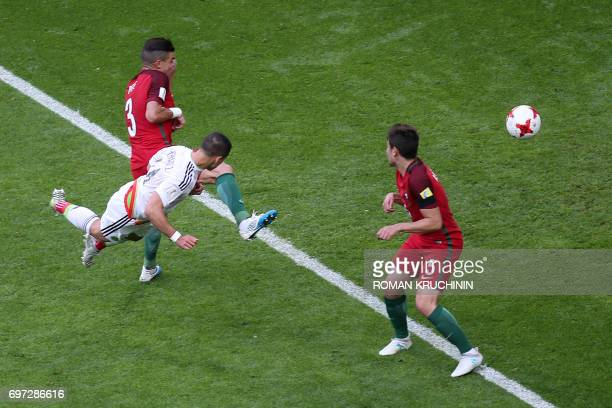 TOPSHOT Mexico's forward Javier Hernandez scores during the 2017 Confederations Cup group A football match between Portugal and Mexico at the Kazan...