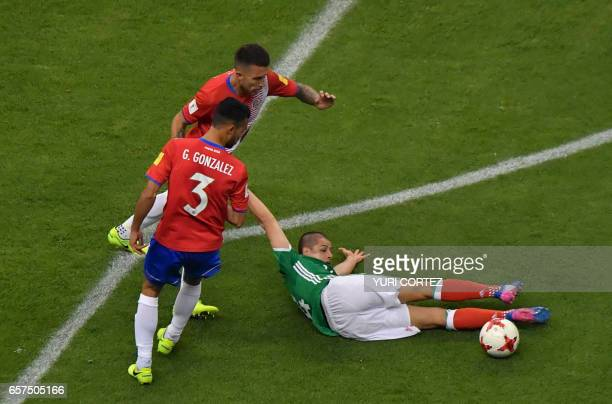 Mexico's forward Javier Hernandez vies for the ball with Costa Rica's defender Giancarlo Gonzalez and Costa Rica's defender Francisco Calvo during...
