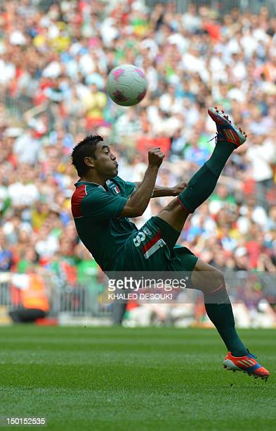 Mexico's forward Marco Fabian controls the ball during the men's football final match between Brazil and Mexico at Wembley stadium during the London...