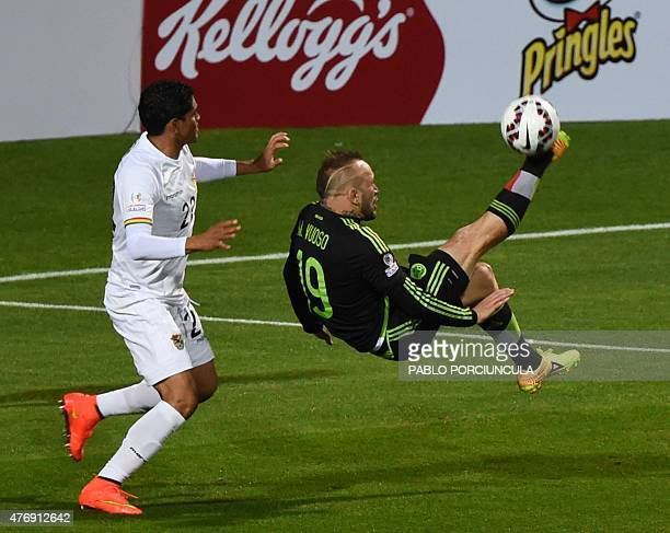 Mexico's forward Matias Vuoso kicks the ball next to Bolivia's defender Edward Zenteno during their Copa America football match in Vina del Mar Chile...