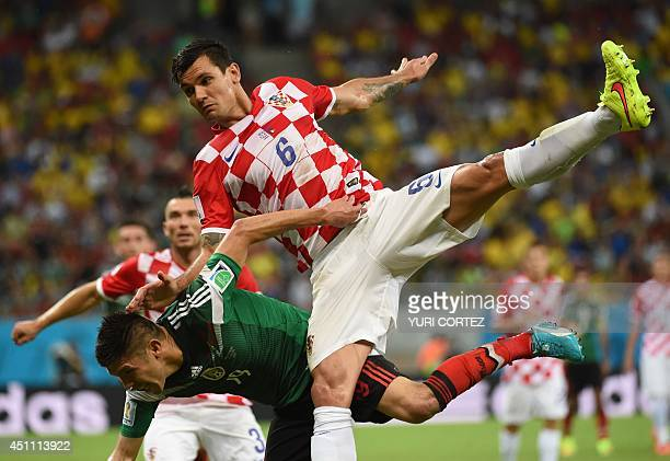 Mexico's forward Oribe Peralta and Croatia's defender Dejan Lovren vie for the ball during a Group A football match between Croatia and Mexico at the...