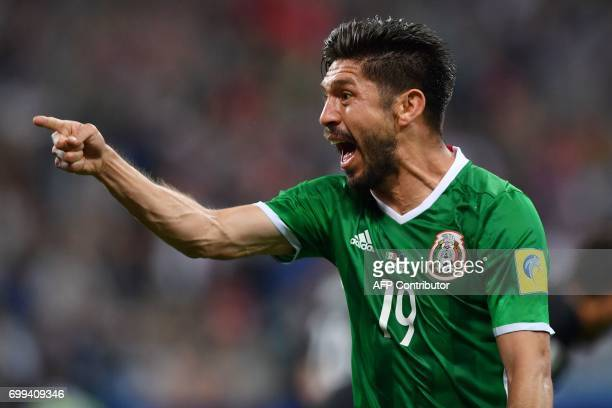 TOPSHOT Mexico's forward Oribe Peralta celebrates after scoring a goal during the 2017 Confederations Cup group A football match between Mexico and...